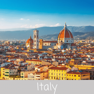 Travel Italy - Stunning Italian architecture in Florence, Italy with blue clear sky and mountains in the background